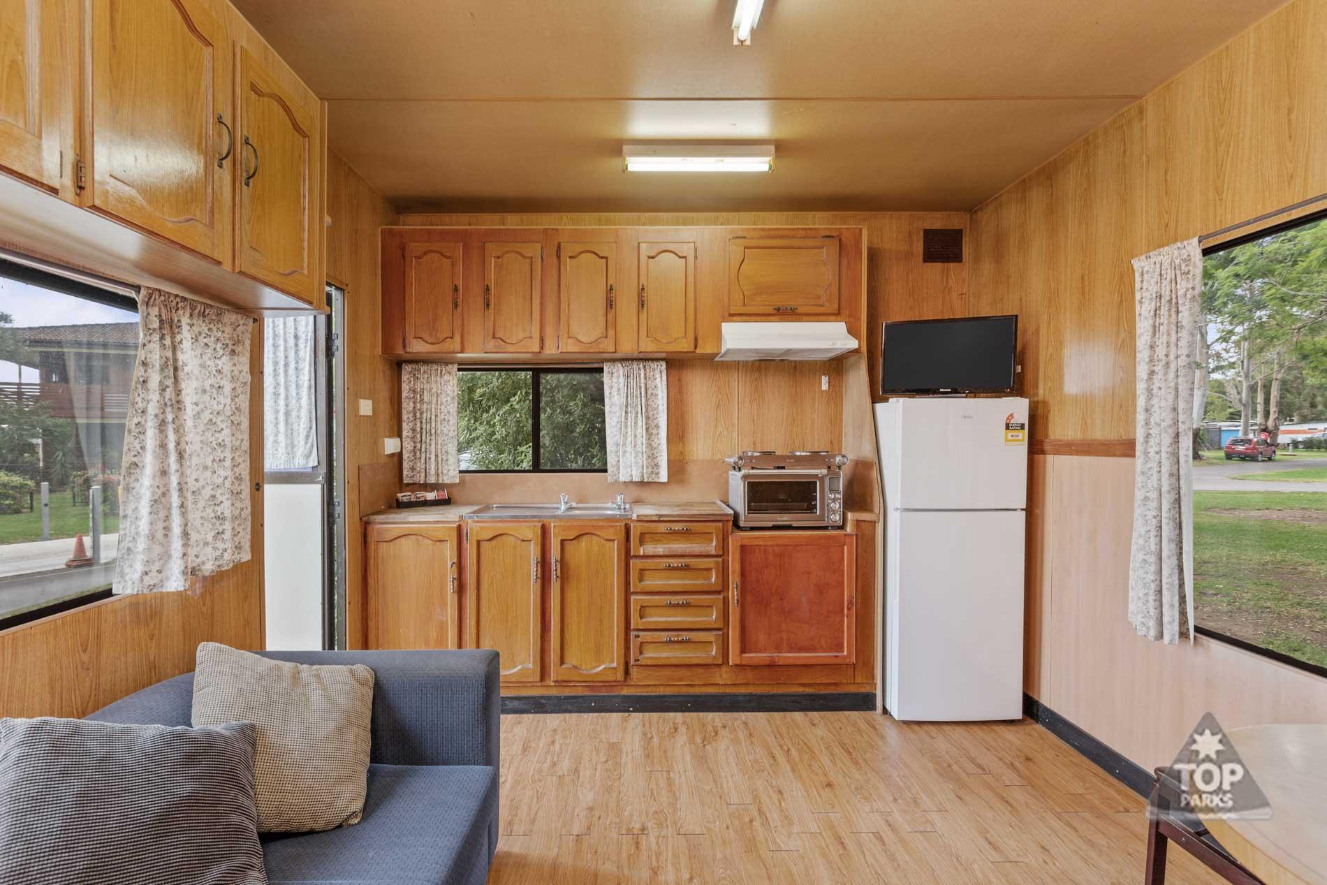 shoalhaven-caravan-village-basic cabin-kitchen-lounge